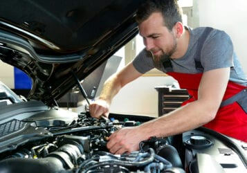 Auto Repair Business for sale in Central North Dakota mechanic under hood of car